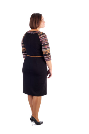 pretty young woman demonstrating a dress, back view Stock Photo