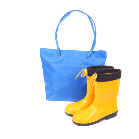 bright blue bag and yellow rubber shoes