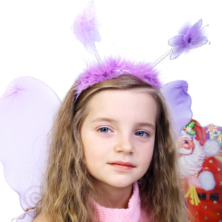 pretty little girl in a special costume of a butterfly