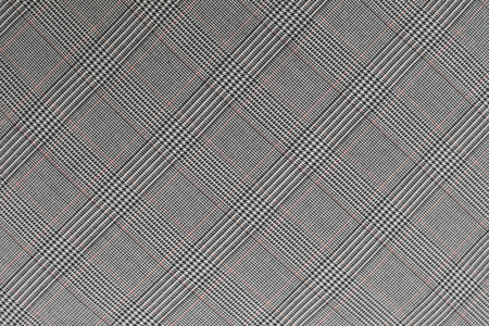 grey rhomb patterned textile background Stock Photo