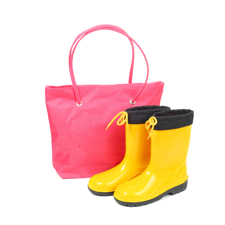 bright pink bag and yellow rubber shoes