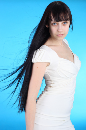 beautiful young brunette girl over blue background