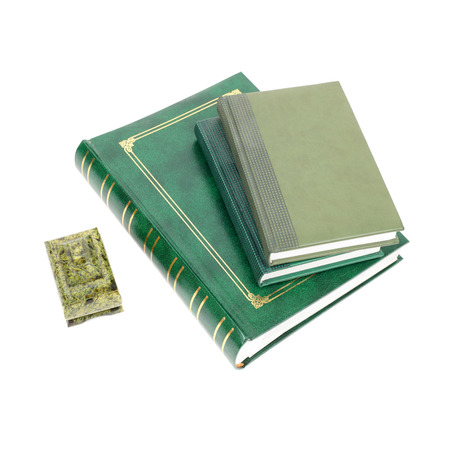 green foliant books isolated on white