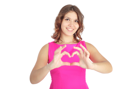 pretty young girl making a heart symbol with her hands