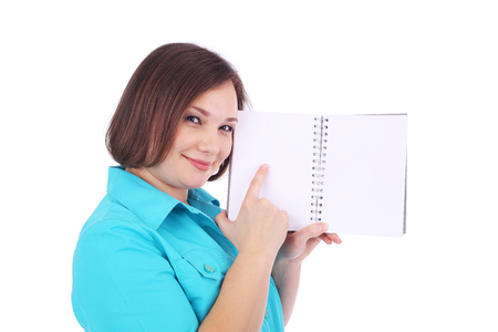 pretty young woman pointing at the grey writing book