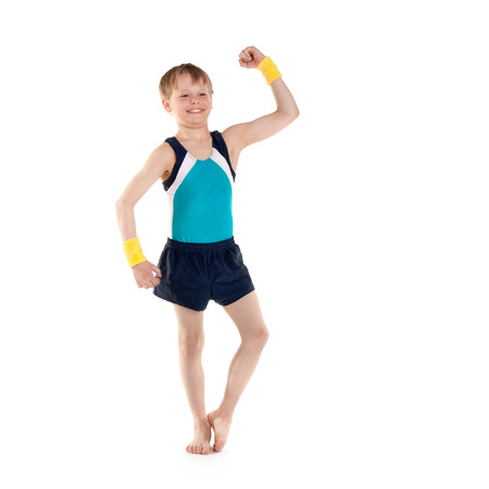 little boy gymnast showing his muscles Stok Fotoğraf