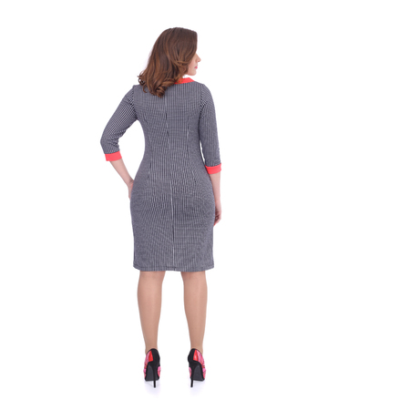 young woman wearing the office dress, back view