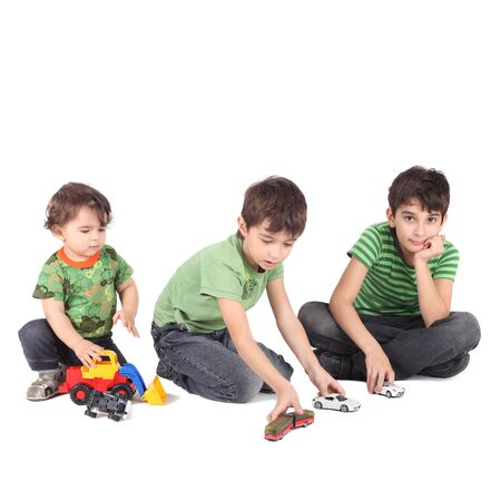 three boys with toy cars