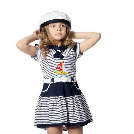 beautiful little girl in a marine dress Stock Photo