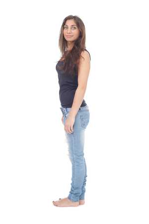 pretty teen girl wearing ripped jeans Stock Photo