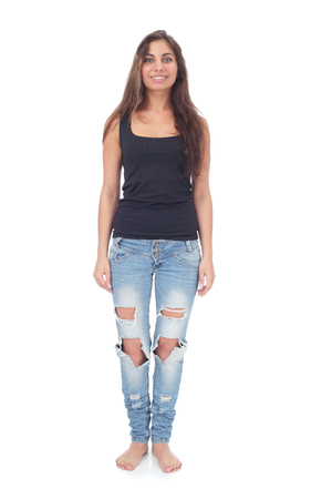 pretty teen girl wearing ripped jeans 스톡 콘텐츠