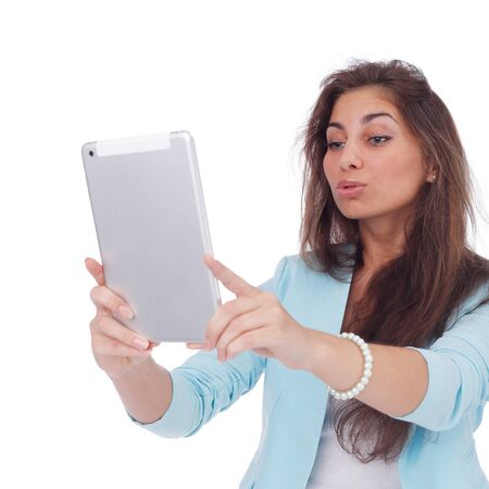 pretty young girl making selfie with the PC tablet