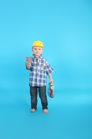 cute handsome little child playing with the instruments Stock Photo