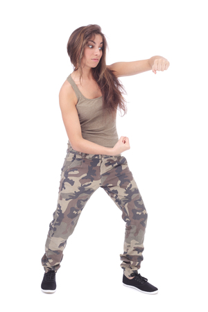 aggressive girl wearing military clothing fighting  isolated on white