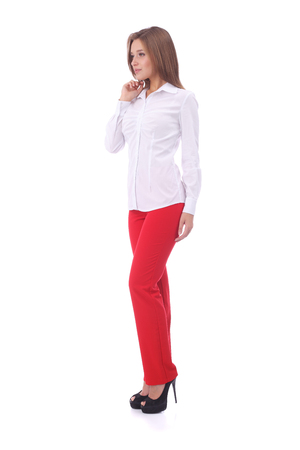 pretty young girl wearing white office blouse and red pants Banco de Imagens