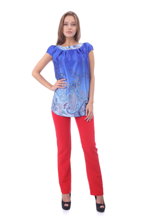 pretty young girl wearing blue tunic and red pants Stock Photo