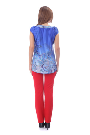 pretty young girl wearing blue tunic and red pants 免版税图像