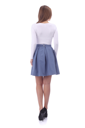 pretty young girl wearing white top and blue skirt Stock Photo