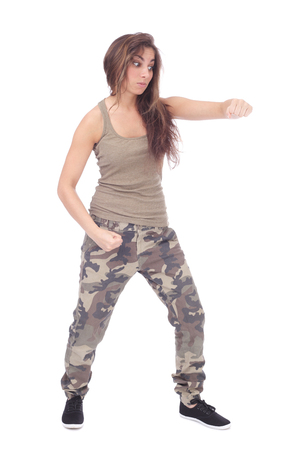 aggressive girl wearing military clothing fighting