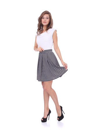 pretty young girl wearing short striped skirt
