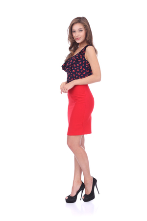 pretty young girl wearing red skirt and lips printed top