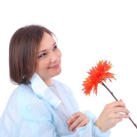 pretty young doctor with the red flower Stock Photo
