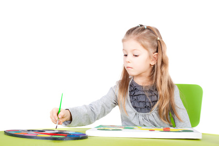 cute little talented girl painting Stock Photo