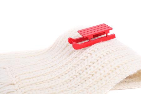 red wooden sledge christmas souvenir on the white scarf mountain