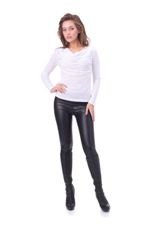 pretty young girl wearing white top and black leather trousers Stok Fotoğraf