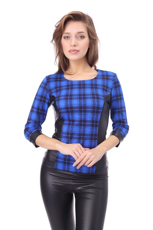pretty young girl wearing blue checked top and black leather trousers