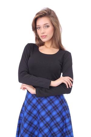 pretty young girl wearing black top and blue checked skirt with high boots