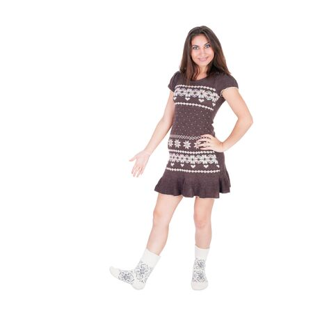 pretty young girl in the warm socks and knitted dress 스톡 콘텐츠