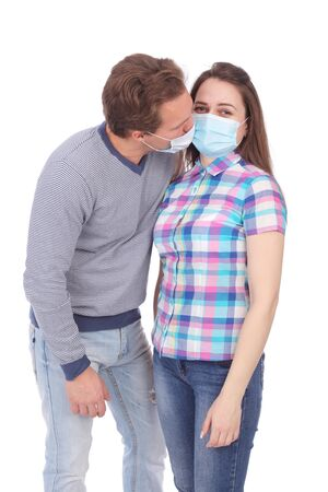 young couple wearing medical masks 스톡 콘텐츠