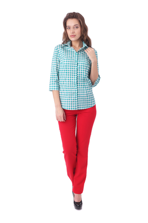 pretty young woman wearing check shirt and red pants