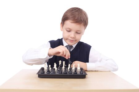 cute little boy playing chess