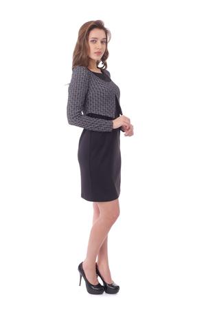 pretty young woman wearing black dress and grey bolero