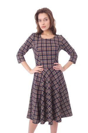 pretty young woman wearing check dress
