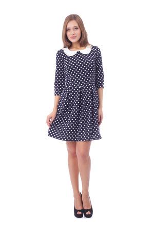 pretty young girl demonstrating polka dot dress