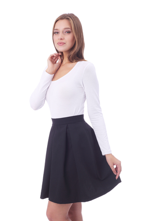 pretty young girl wearing white top and black skirt Stock Photo