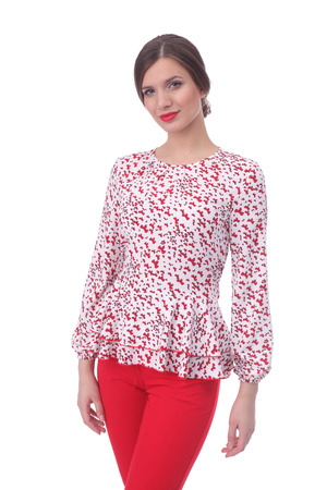 pretty young woman wearing summer bow printed top and red pants Stock Photo