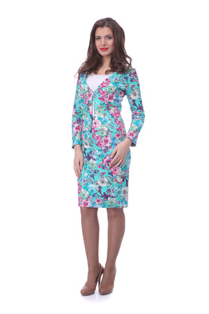 pretty young woman wearing floral printed jacket and skirt Stock Photo