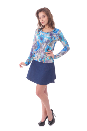 pretty young girl wearing jeans skirt and flower print top Stock Photo