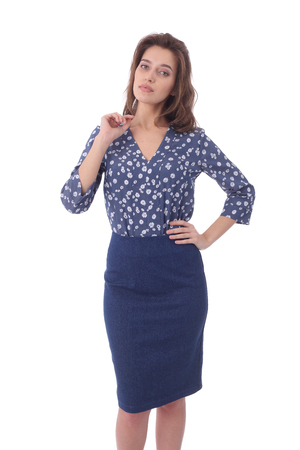 pretty young girl wearing blue formal skirt and flower print blouse