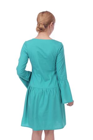 pretty young girl wearing green dress