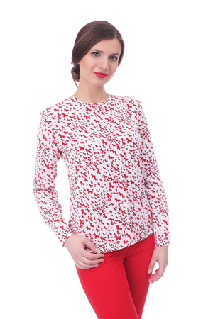 pretty young woman wearing summer bow printed blouse and red pants Stock Photo