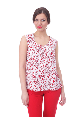 pretty young woman wearing summer bow printed top and red pants Banque d'images