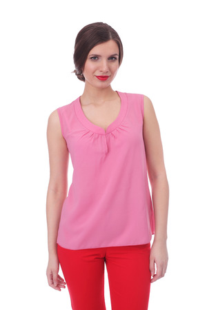 pretty young woman wearing summer pink top and red pants Stock Photo