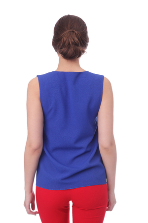 pretty young woman wearing summer blue blouse and red pants 스톡 콘텐츠