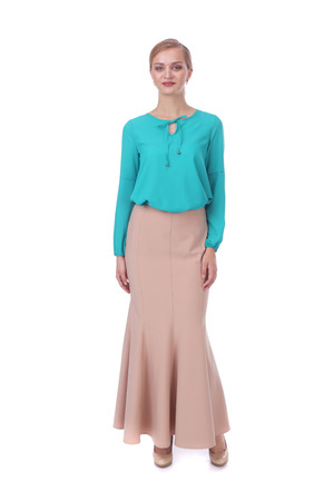 pretty young girl wearing long beige skirt and green blouse