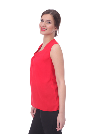 pretty young woman wearing summer red blouse and pants 스톡 콘텐츠